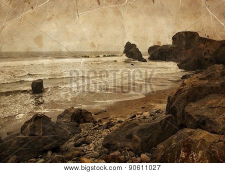 Beautiful water of the ocean, big rocks and mountain background, summer beach, rocks on the ocean sh