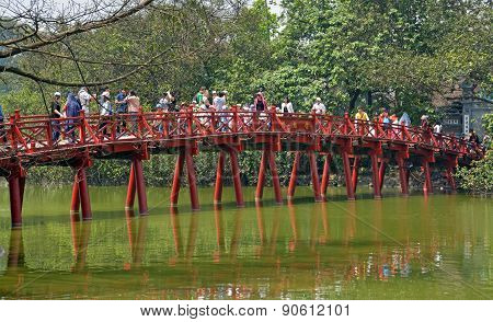 Tourists On Red Bridge Lake Hoan Kiem Hanoi In Spring.