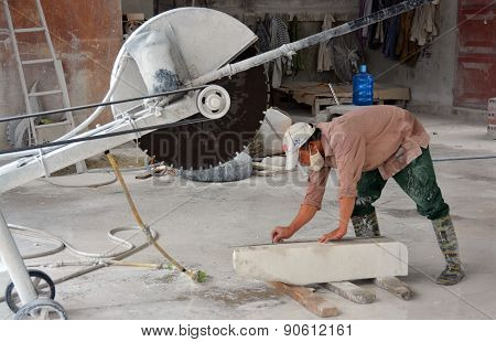 Man Cutting Block Of Marble In Ha Long Bay Vietnam