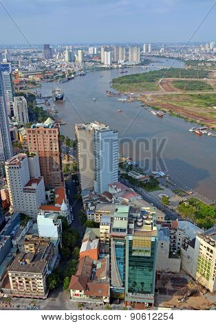 Vertical Aerial View Of Saigon River And City In The Afternoon.