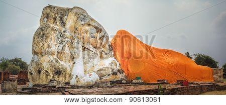 Giant Reclining Buddha in Wat Lokayasutharam. Ayutthaya historical park. Panorama