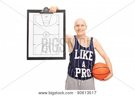 Senior basketball coach showing a clipboard with a basketball court on it isolated on white background