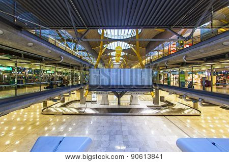 Passengers Walk By At The New Terminal T4 At Barajas Airport On April 1,2012 In Madrid. This Additio