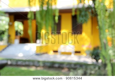 Blur Yellow House With White Chair