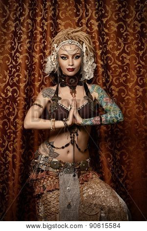 Beautiful traditional female dancer. Ethnic dance. Belly dancing. Tribal dancing.