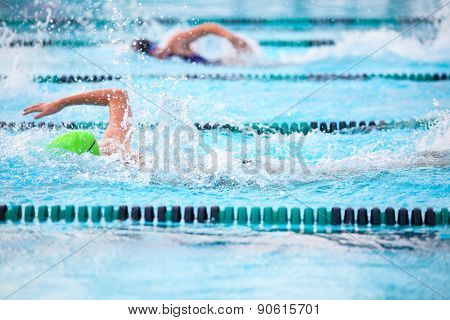 Freestyle race . Focus on water splash