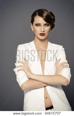 Fashion shot of a beautiful model posing at studio. Beauty, fashion. Make-up.