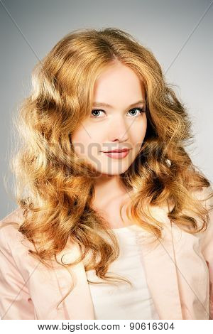 Close-up portrait of a beautiful young woman. Make-up, body care.