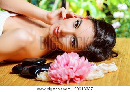 Beautiful young woman getting spa treatments at a beauty salon. Healthcare, body care.