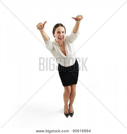 view from above of laughing businesswoman in formal wear with thumbs up over light grey background