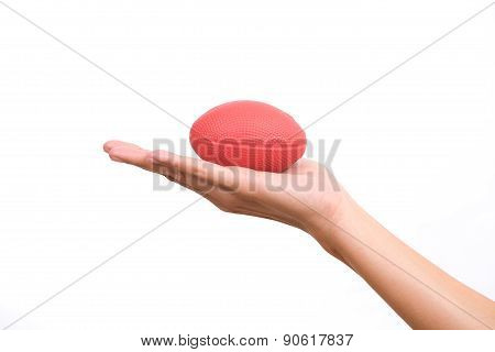 Hands Of A Woman Holding A Stress Ball On White Background
