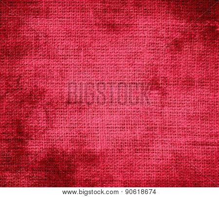 Grunge background of amaranth burlap texture