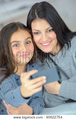 Mother and daughter taking a photo of themselves