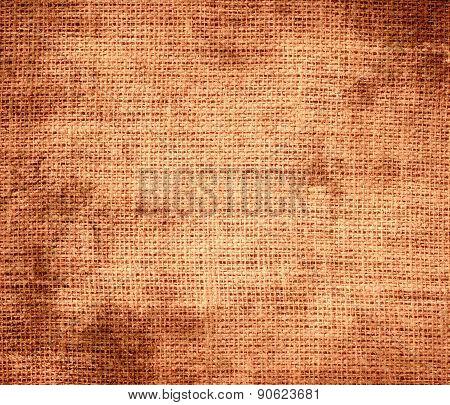 Grunge background of atomic tangerine burlap texture