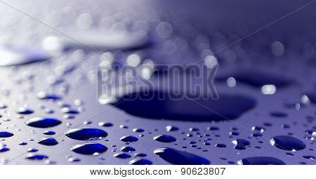 Water Drops On Blue Car Metal