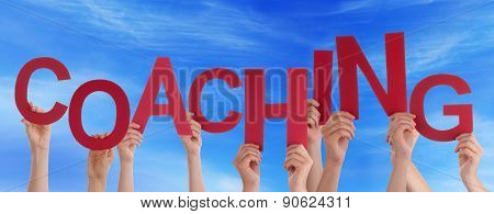 Many People Hands Hold Red Word Coaching Blue Sky
