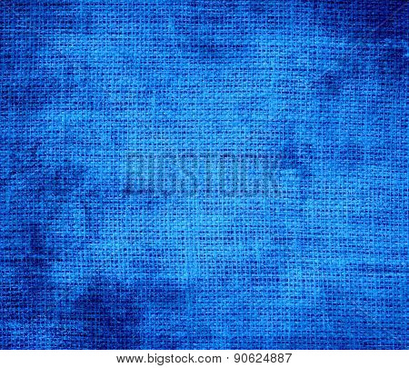 Grunge background of azure burlap texture