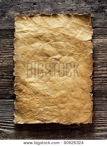 old paper on brown aged wood