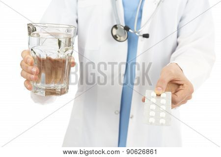 Doctor Giving Medicine With A Glass Of Water