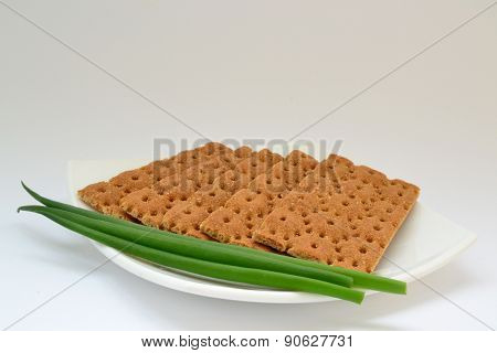 Dietary Bread With Green Onion On White Plate