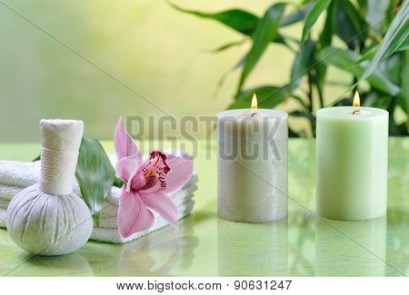 spa still life with lilac orchid on green background