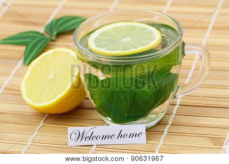Welcome home card with mint tea and lemon