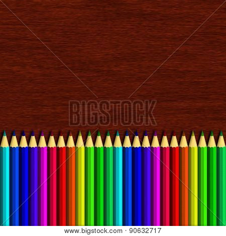 Colour Pencil Lying On Wooden Table