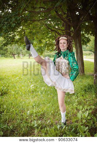 Young Beautiful Girl In Irish Dance Dress Dancing Outdoor