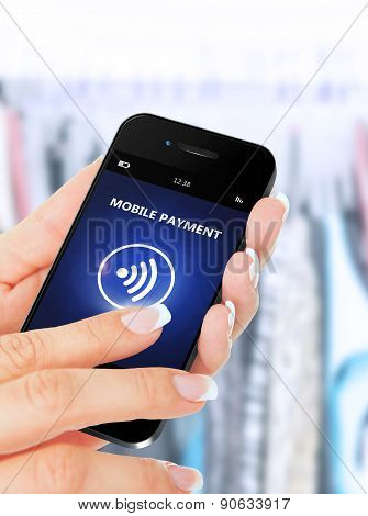 Hand Holding Mobile Phone With Mobile Payment Application