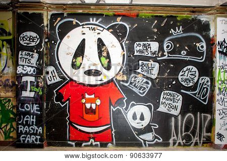 Painted Graffiti In An Abandoned Factory Building