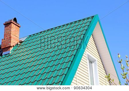 Mint Color Tiled Roof And Brick Chimney.