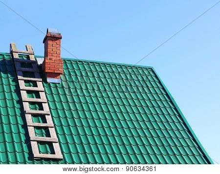 Wooden Ladder On Mint Color Tiled Roof.