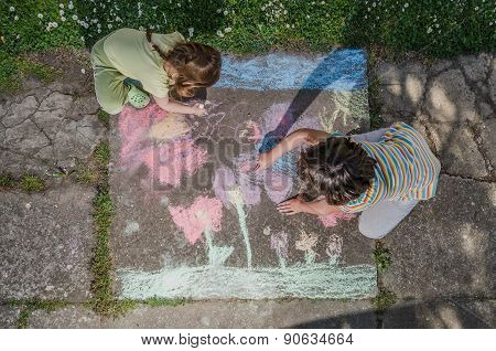 Kids Drawing with Chalk on Sidewalk