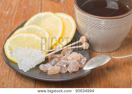 Chrystal Sugar With Lemon And Tea