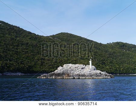 A lighthouse on a rock in the Mediterranean