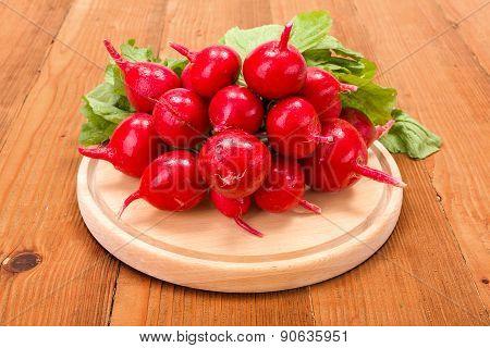 Fresh Red Radish On Wooden Cutting Board