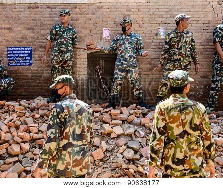 KATHMANDU, NEPAL - MAY 14, 2015: Military personnel during a rescue operation after a 7.3 earthquake that hit Nepal two days ago.