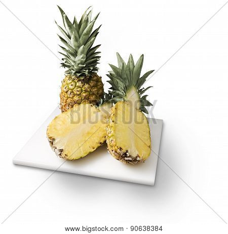 Pineapples On Cutting Board Isolated On White