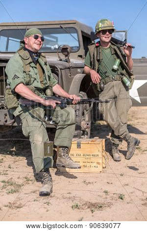 NELIDOVO, RUSSIA- JULY 12, 2014: Battlefield 2014: Two US soldiers in sunglasses standing near the car