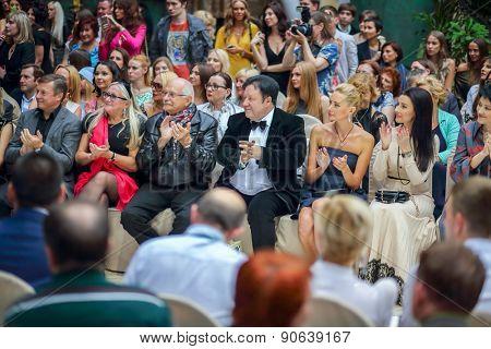 MOSCOW - JUNE 26, 2014: Nikita and Tatiana Mikhalkov watch fashion show Russian Silhouette in Zurab Tsereteli Art Gallery