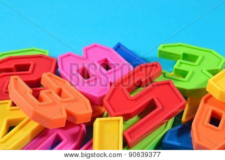 Colorful Plastic Numbers On A Blue Background
