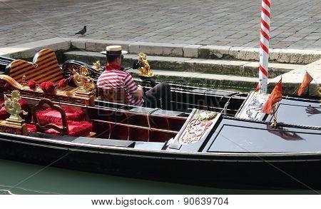 Gondolier resting in Venice