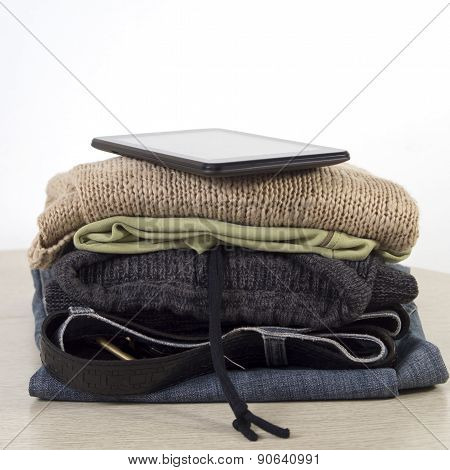Stack Of Clothes On A Wooden Table