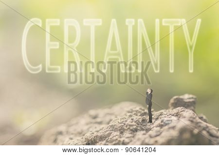 Concept of guarantee with a person stand in the outdoor and looking up the text over the sky in nature background.