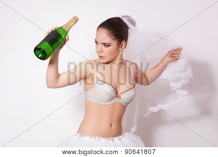 Sad Bride With A Bottle Of Champagne In Hand