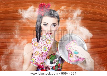 Surprised Woman Cook Lifting Lid Of A Funny Recipe Inside Kitchen Interior. Prepare Food At Home