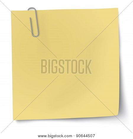 Yellow Sticky Note With Metallic Paper Clip