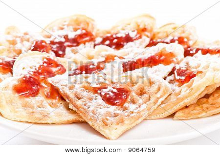 Stack Of Waffles In Shape Of Heart With Strawberry Jam And Sugar