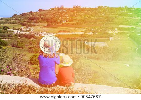 mother and son looking at scenic country views in Malta