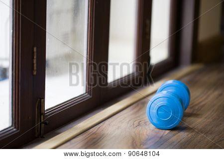 Dumbbell Beside A Door